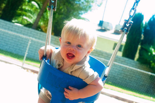 Garrett plays in a swing
