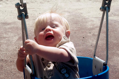 Garrett plays in a swing