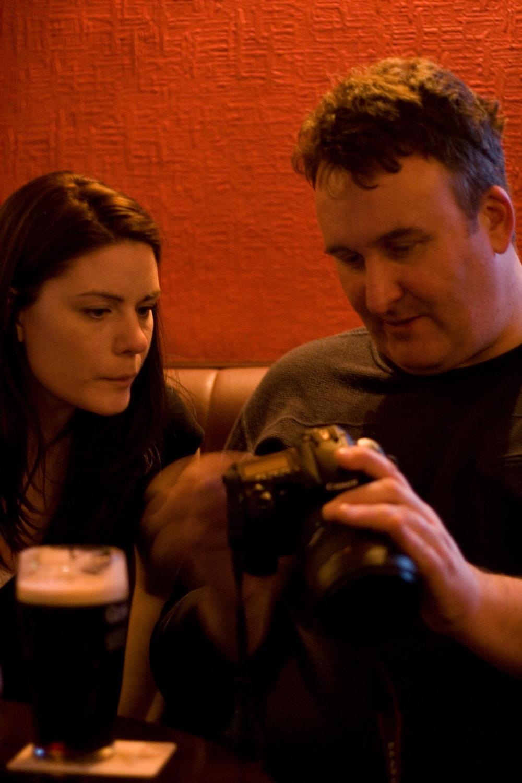 Julie checks Simon's camera