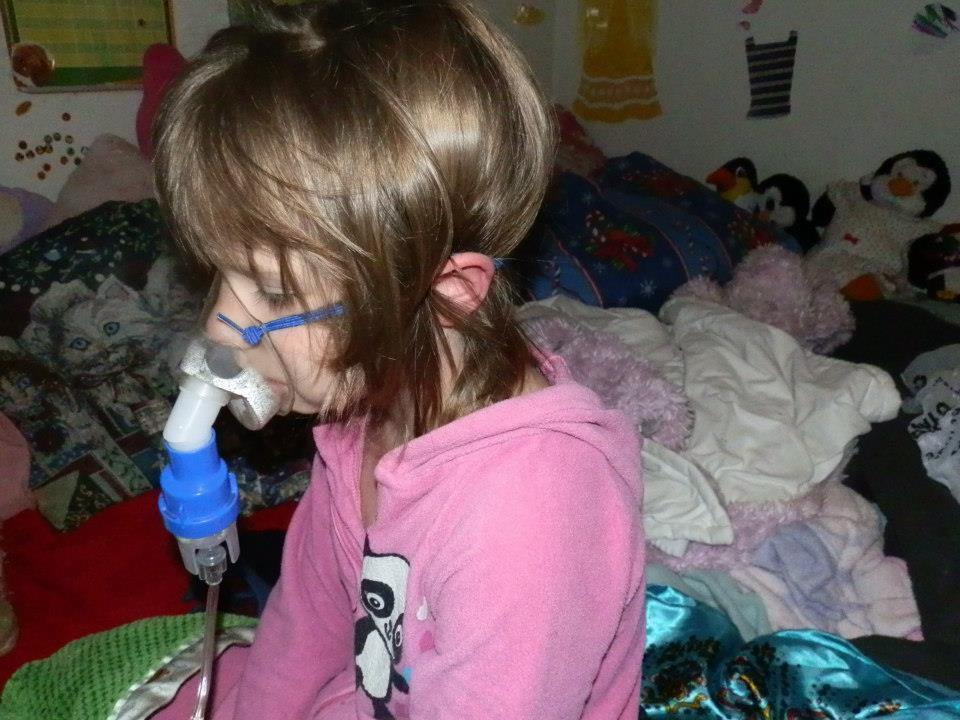Sick Caira in bed, by Elizabeth Clanton, December 2012