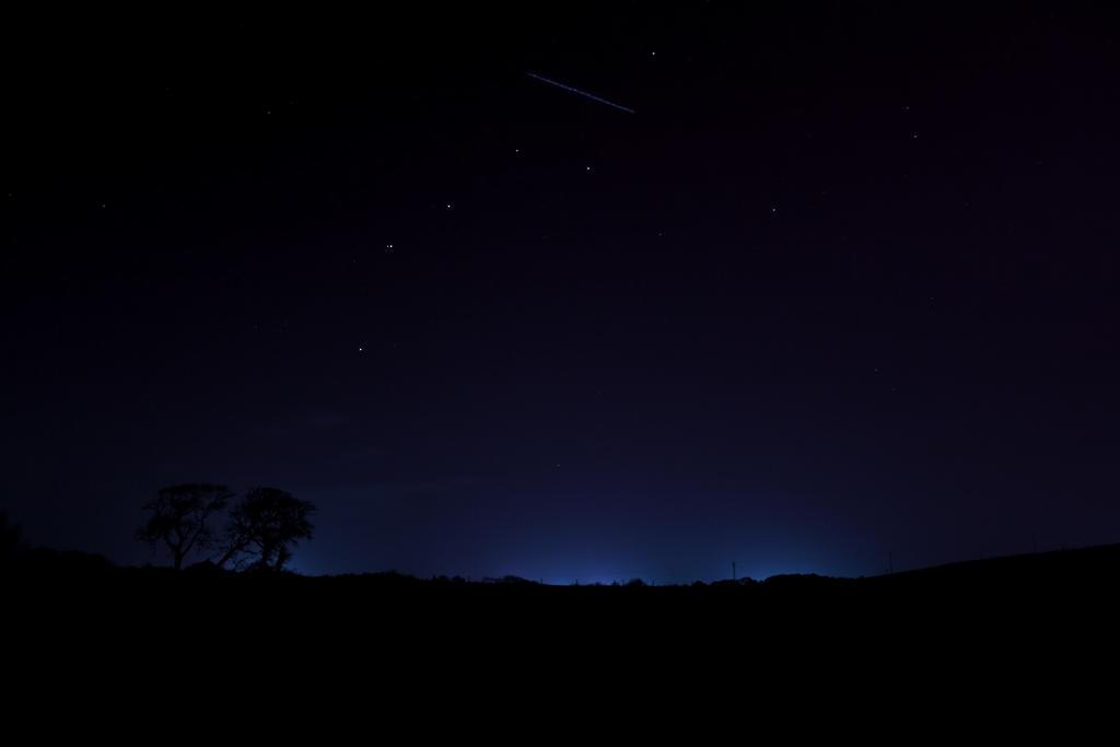 A satellite crossing through the constellation of Ursa Major
