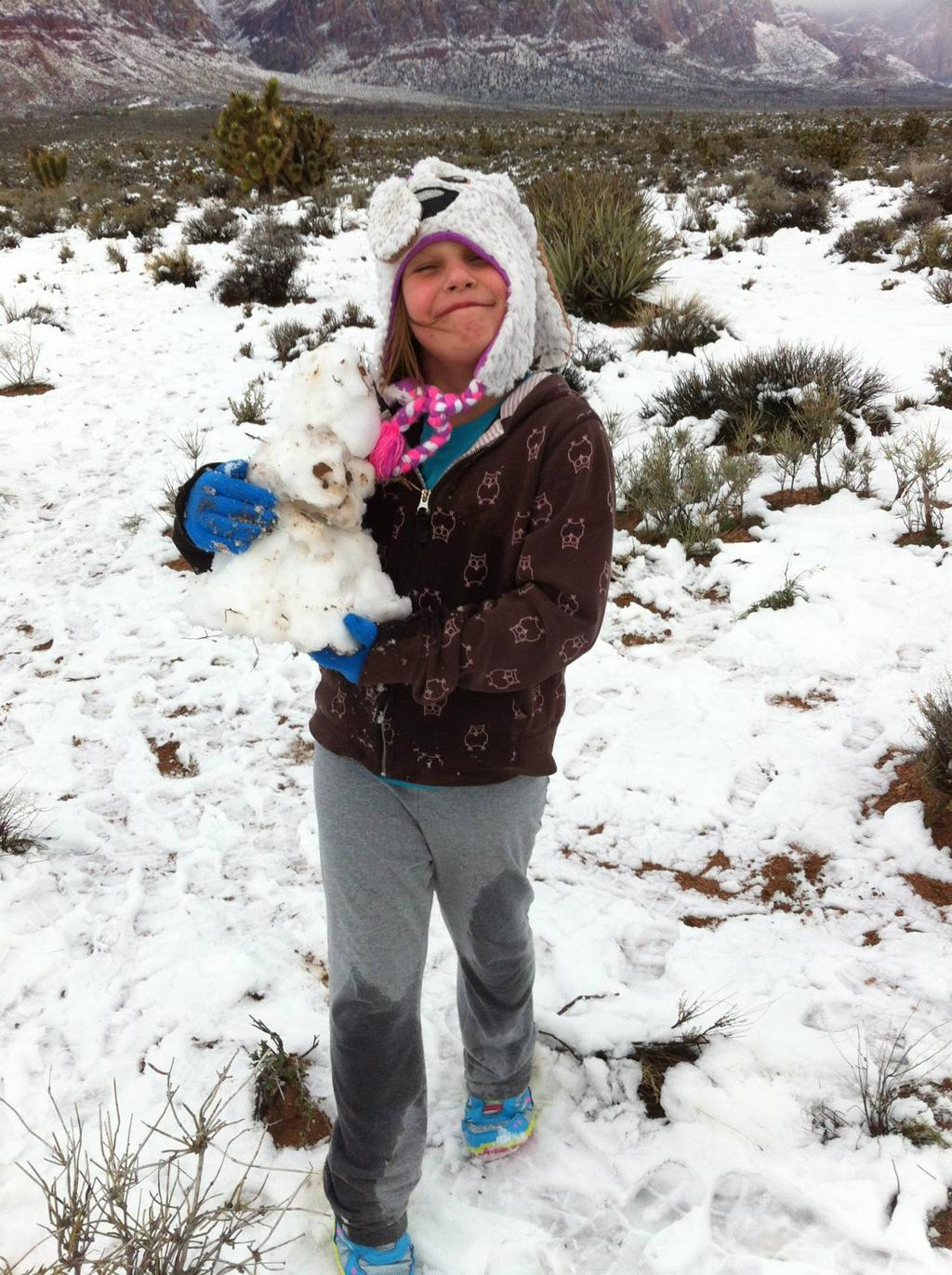 Caira playing in the snow at Red Rock