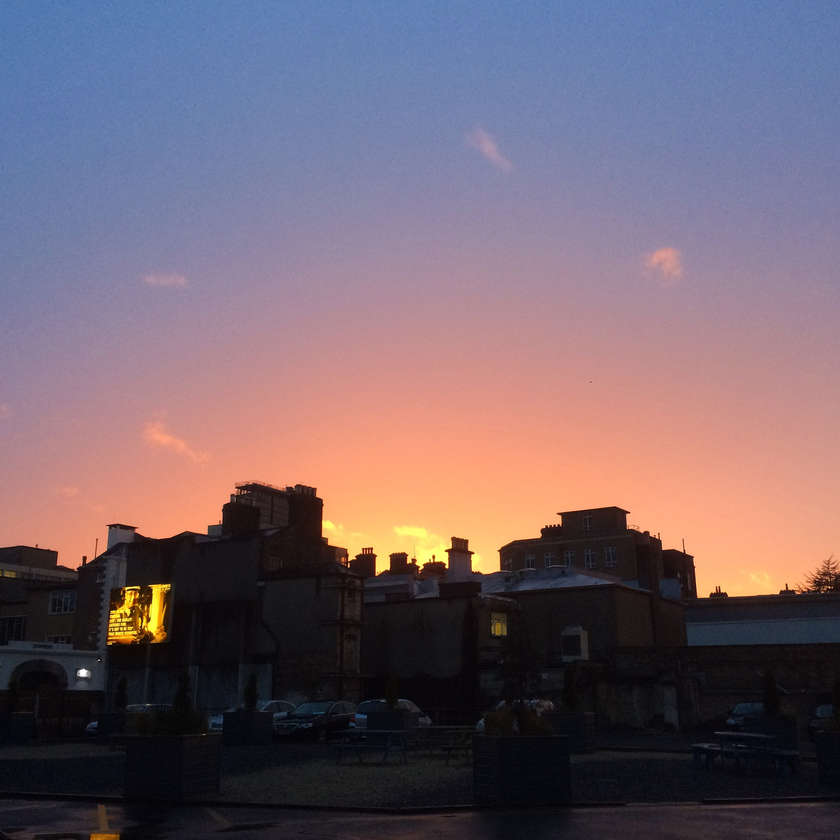 Sunset over Saint James Gate