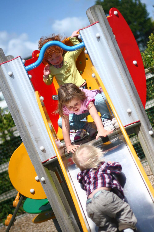 Caira, Garrett and Ella on the slide