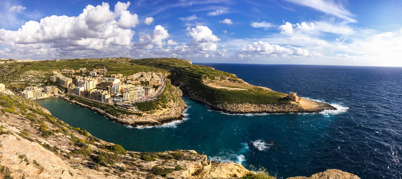 Panorama of Xlendi from above on the cliffs