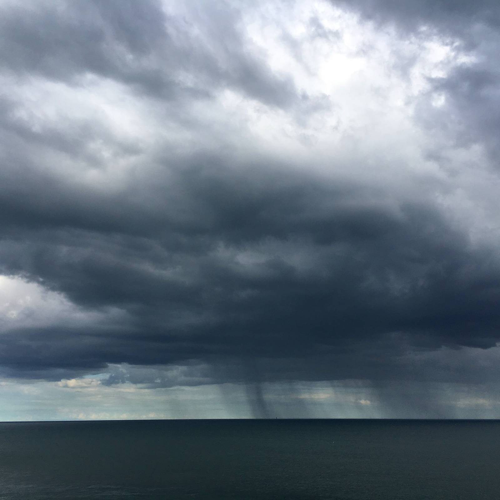 Rainc clouds over the Irish Sea, seen from Howth