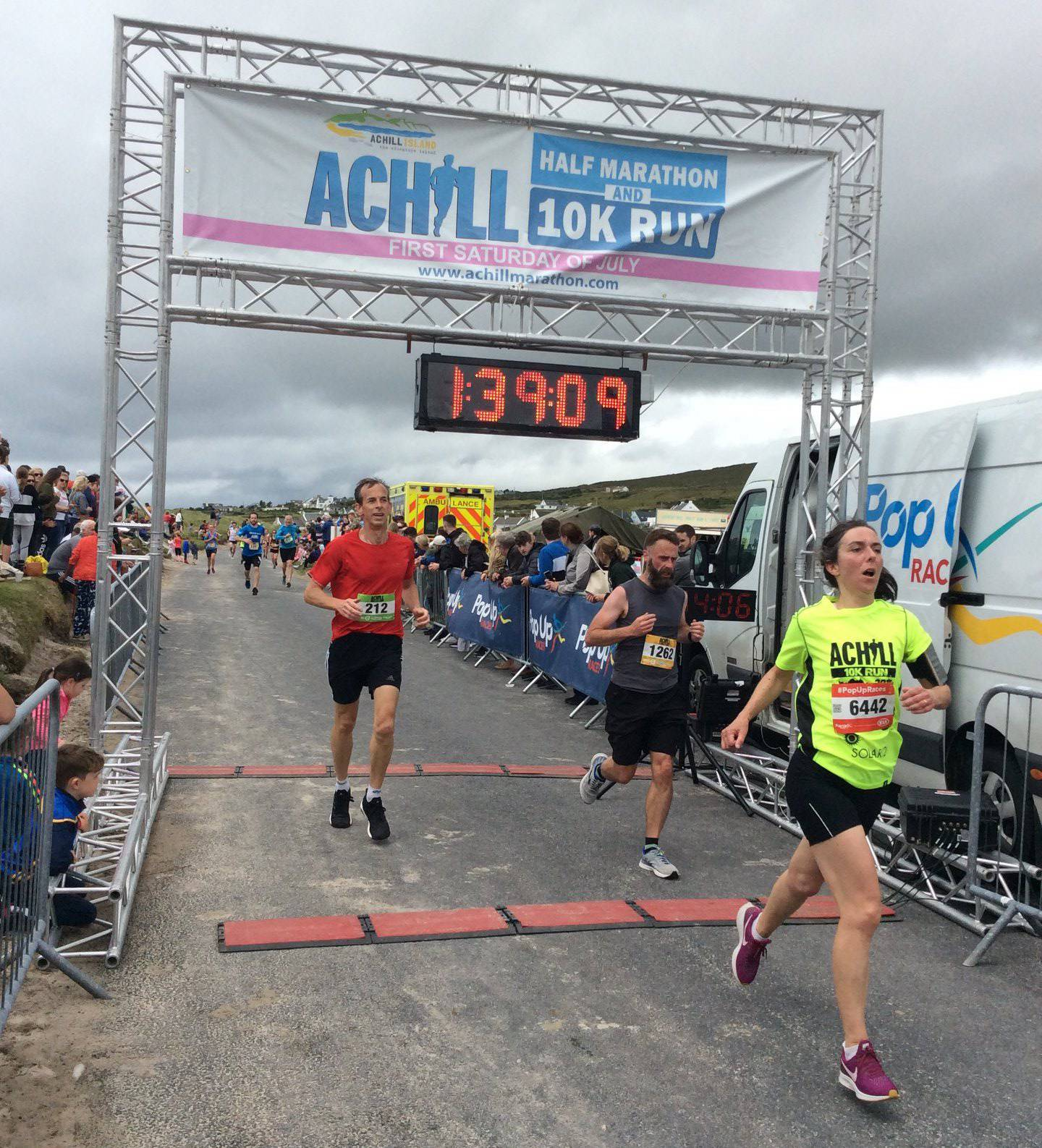 Me crossing the Achill half marathon finish line