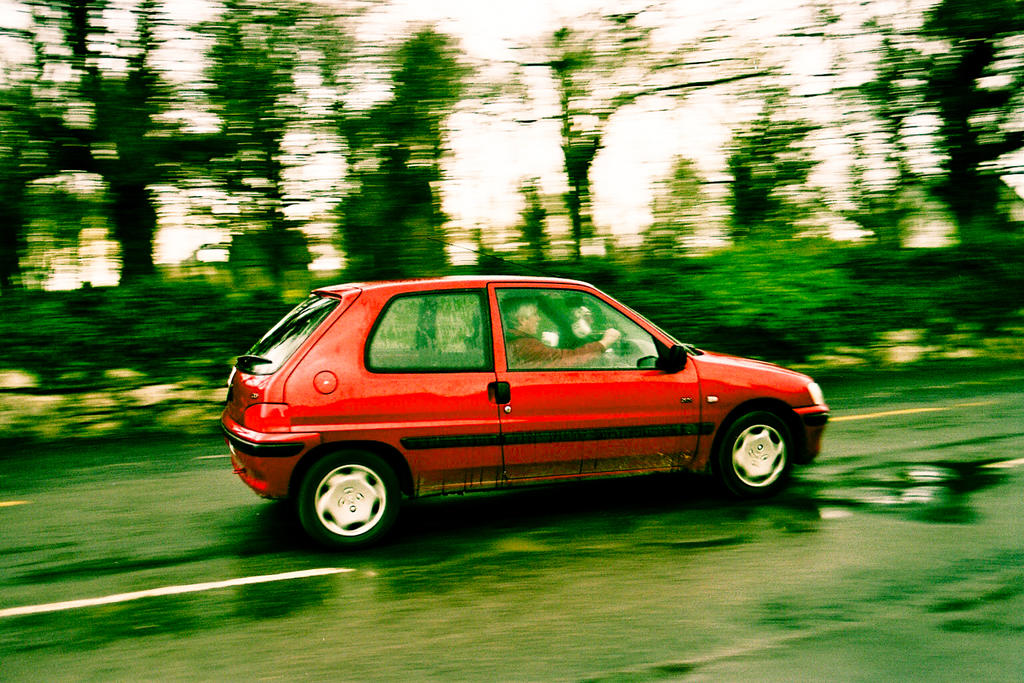 Panning a car outside of Renville Forest Park, Oranmore
